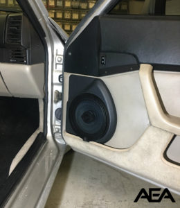 Custom door fabrication to house a JL Audio TR650-CXi coaxial speaker in a 1987 Porsche 944.