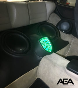 Custom enclosure for 2 JL Audio 10W3 subwoofers with etched plexiglass LED Porsche logo and a custom mid-range enclosure for JL Audio TR-650CXi coaxial speakers in a 1987 Porsche 944.